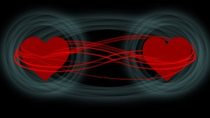 Illustration of quantum entanglement showing two hearts connected.